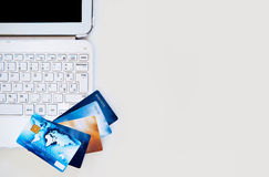 Credit cards on the desk with computer Stock Photos