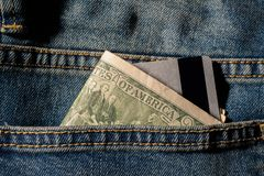 Credit cards and dollars in cash Stock Image