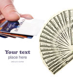 Credit cards and dollars fan. Credit cards and two thousand american dollars isolated on white Royalty Free Stock Image