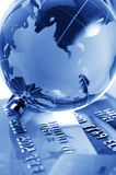 Credit cards and globe Stock Photo