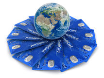 Credit Cards with Globe (clipping path included) Royalty Free Stock Images