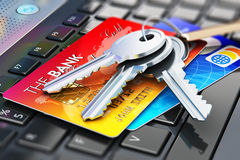 Credit cards and house keys on laptop keyboard Stock Photography