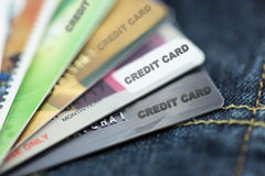 Credit cards on jeans. Focus at first card Stock Photography