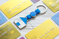 Credit cards, key ring - concept mortgage on wooden background Stock Photography