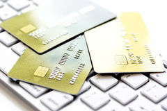 Credit cards on the keyboard close up Royalty Free Stock Image