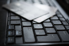Credit cards on keyboard Royalty Free Stock Images