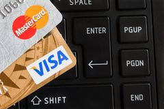 Credit cards on keyboard of notebook. Royalty Free Stock Photos