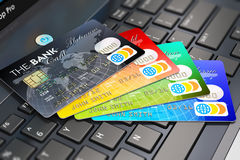 Credit cards on laptop keyboard Royalty Free Stock Images