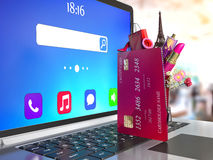 Credit cards on laptop keyboard. Internet shopping Stock Images