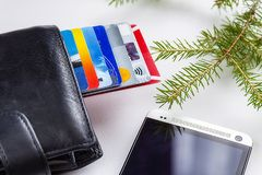 Credit cards in a leather wallet on a light background royalty free stock image