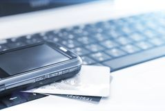 Credit cards and mobile phone on the laptop Royalty Free Stock Image
