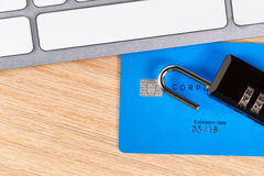 Credit cards with open lock on desktop Stock Photo