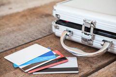 Credit cards and opened steel case Stock Photos