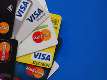 Credit cards over blue with copy space Royalty Free Stock Photos