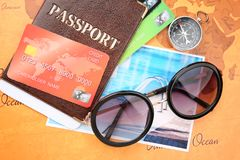Credit cards with passport and ticket for vacations. On world map background royalty free stock images