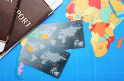 Credit cards with passports and tickets for vacations. On world map background Stock Photo