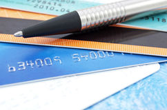 Credit cards and pen. On the table Stock Photo