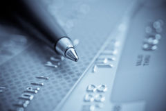 Credit cards and pen. Close-up blue toned shot of credit cards and pen Royalty Free Stock Photo