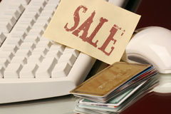 Credit cards sale on line. Stack of credit cards leaning on keyboard ready for sales on line Stock Photography