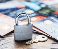 Credit cards and simle mechanical lock. Security concept Royalty Free Stock Image