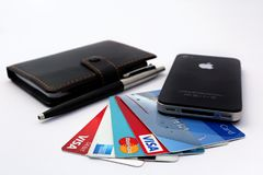 Credit cards on table with smartphone stock image