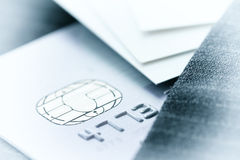 Credit cards in very shallow focus with gray suit background as Stock Image