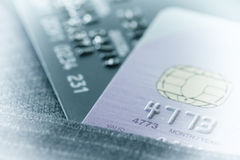 Credit cards in very shallow focus with gray suit background as. Online shopping concept stock photos