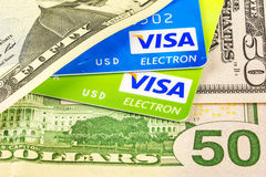 Credit cards Visa and dollar bills Stock Photo