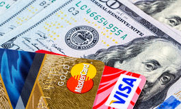 Credit cards, Visa and MasterCard, with US dollar bills Royalty Free Stock Photos