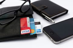 Credit cards in wallet on table with cellphone stock photo