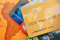 Credit cards. On world map background Stock Images