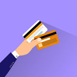 Credit cars in hand flat design vector Stock Images