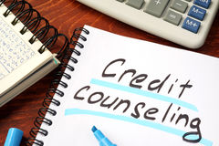 Credit counseling. Credit counseling written in a note and calculator Royalty Free Stock Photography