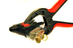 Credit Crunch. Wallet held in a clamp with credit card and euros Royalty Free Stock Image
