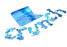 Credit Crunch Card. A concept credit card shattered into pieces that spell out the word crunch on an isolated background Royalty Free Stock Image