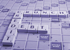 Credit crunch and debt. Letter blocks spelling out credit crunch and debt.  In a pale blue colour for use in finance magazines etc during this economic climate Stock Photography