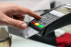 Credit or debit card password payment. Customer hand is entering. Personal identification number in shop or supermarket. Payment terminal keypad, pin. Buy and stock images