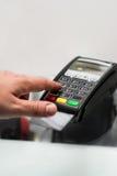 Credit or debit card password payment. Customer hand is entering Stock Photos
