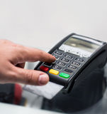 Credit or debit card password payment. Customer hand is entering Royalty Free Stock Photo