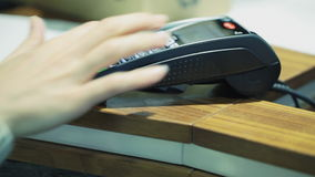 Credit or debit card payment transaction. HD 1080 steadicam: Credit or debit card payment transaction - entering PIN at external terminal stock footage