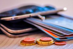 Credit and debit cards and coins in wallet. Royalty Free Stock Photography