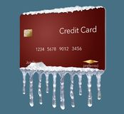 A credit freeze, or freeze on your credit report is represented with icicles and snow on a mock credit card on the backgr royalty free stock photos