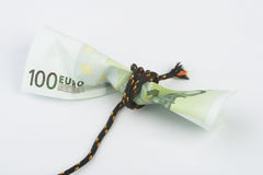 Credit grip. 100 euros strangle by a rope royalty free stock photo
