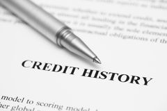 Credit History. Ballpoint pen on  (Credit Report). Focus on the end of ballpoint pen. Shallow depth of field. Black and White. Close-up royalty free stock photography