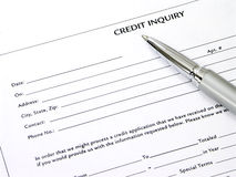 Credit Inquiry Form. With a brushed silver and chrome pen Stock Image