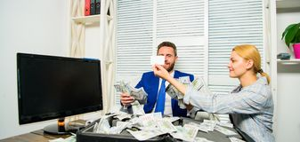 Credit loan and cash concept. Businessman with cash bank client. Office manager hold bank card. Man business owner sit. Office pile of money. Bank assistant royalty free stock photos