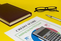 Credit score report with calculator. Credit rating report with keyboard, pen and notepad royalty free stock images