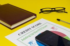 Credit score report with calculator. The credit rating report with keyboard, pen and notepad stock images