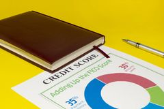Credit score report with calculator. Credit rating report with keyboard, pen and notepad stock photo