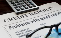 Credit report with score on a desk. And a calculator royalty free stock photography